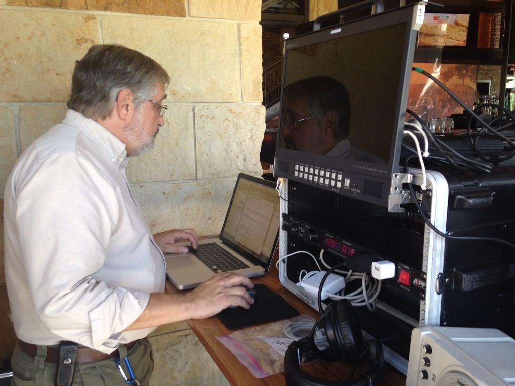 Glenn Hartong prepares for a live to web multi-camera video production.